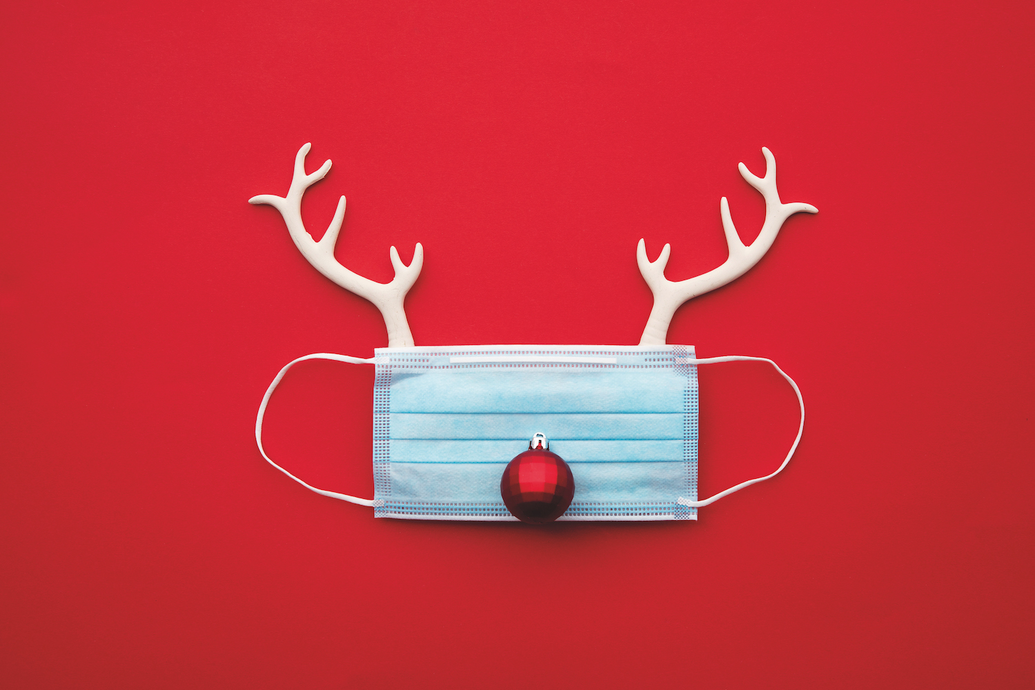Festive christmas reindeer made from face mask and decorations,