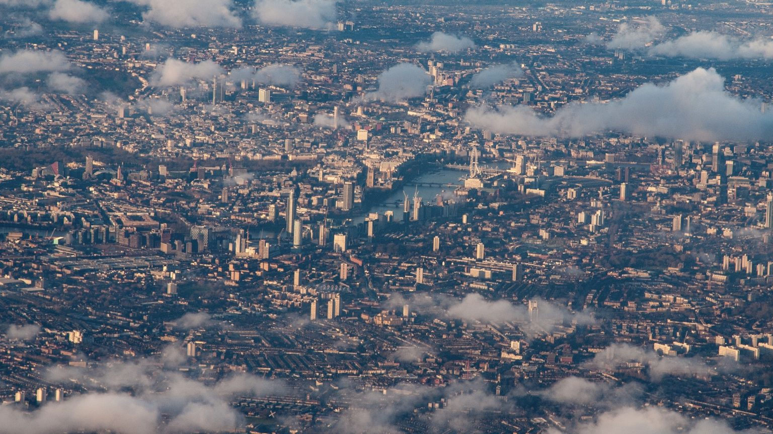 Aerial view of central London through patchy clouds