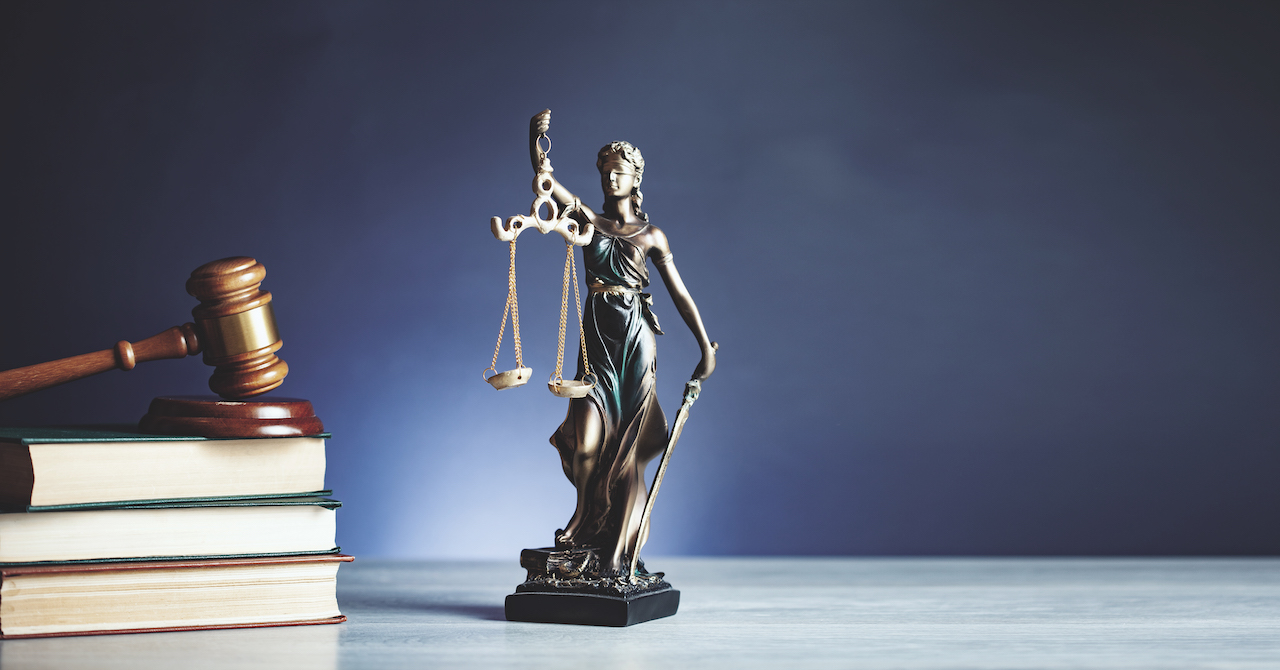 lady justice with hammer on book